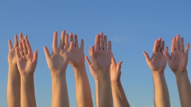 depositphotos 104849178 stock video hands up on blue sky