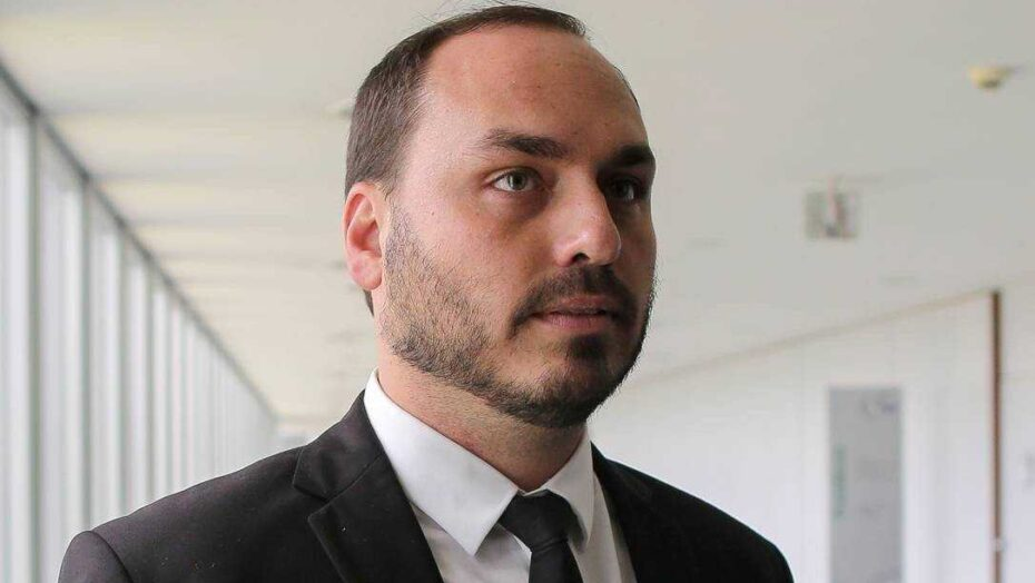 x79860176 Carlos Bolsonaro son of Brazils President elect Jair Bolsonaro is pictured during his.jpg.pagespeed.ic .FtAAGKy5sK