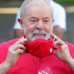 file photo former brazils president luiz inacio lula da silva puts on a face mask after vo
