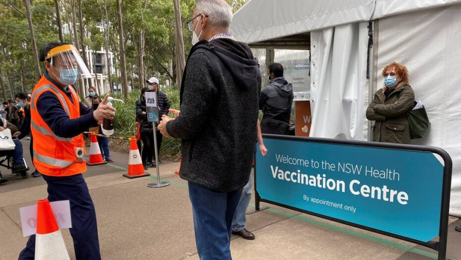 x People wait outside a coronavirus disease COVID vaccination centre at Sydney Olympic jpg pagespeed ic GmamTbSPQN