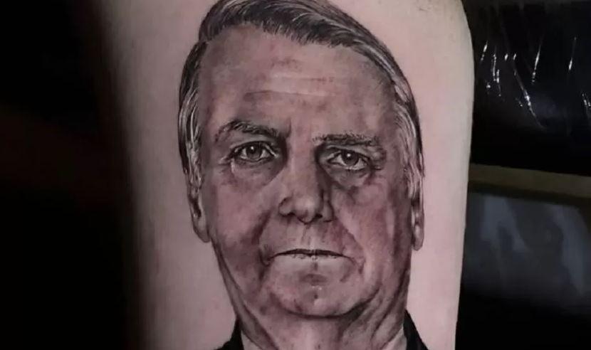 """Renan, filho """"04"""" de bolsonaro, tatua o rosto do pai no braço"""