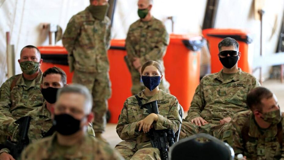 x FILE PHOTO US soldiers wearing protective masks are seen during a handover ceremony of jpg pagespeed ic wk iEAYHf